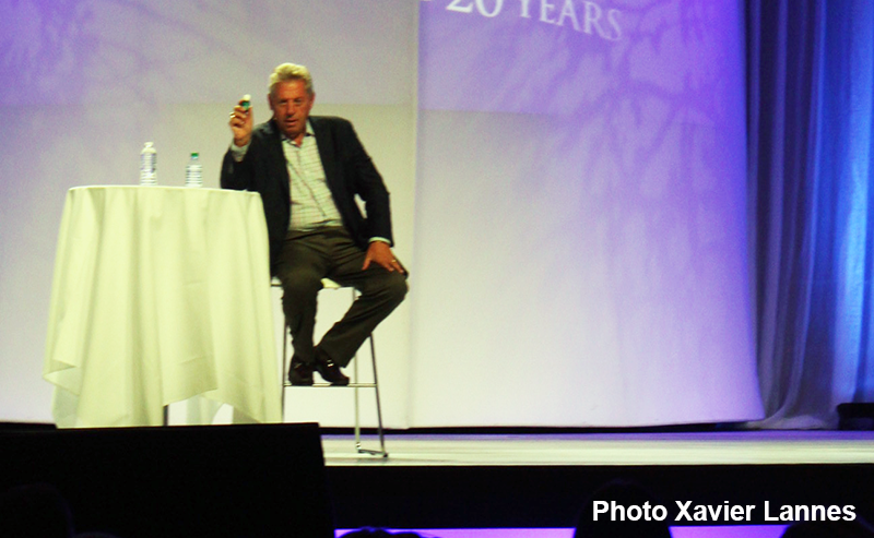 John Maxwell on Stage explaining why he loves essential oils